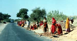 Colourful Sari-Clad Women working at roadside