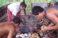 The boys making the umu for Dad's unveiling
