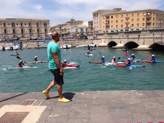 Kayak polo between the bridges between Ortygia & Syracusa – A very popular summer sport here