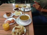 Maroc Chefchaouen - ramadan breaking fast with harira, sweet pastries, bread, fresh orange juice, boiled eggs, dates