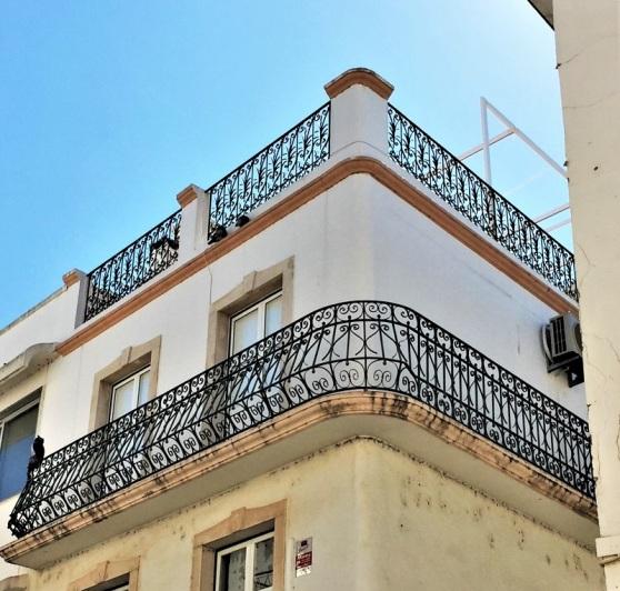 Wrought Iron - wraparound balcony