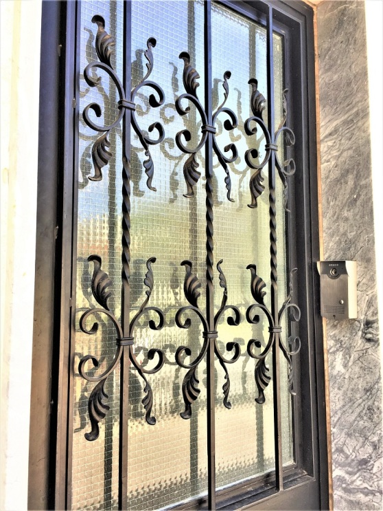 Wrought Iron - wired glass window